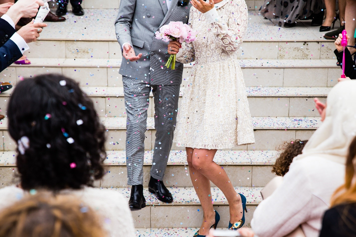 newlyweds on the stairs