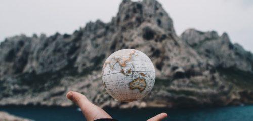 handing undeneath a hovering globe