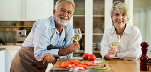 older couple enjoying retirement and a glass of white wine